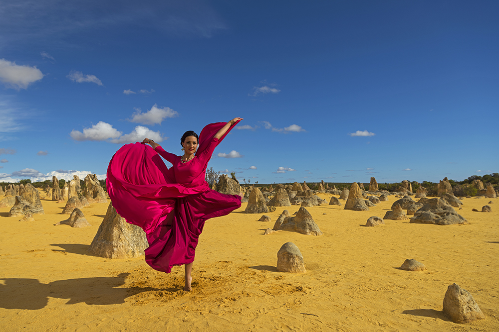 Ballet dancer in flowing pink dress pirouetting in the Pinnacles Desert, photographed with the Nikon 24-70mm f2.8 VR lens