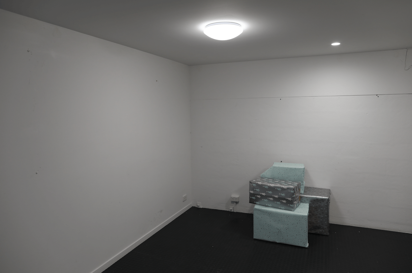 empty studio space before props and lighting setup