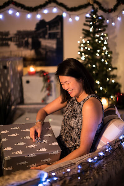 woman opening a gift in christmas day