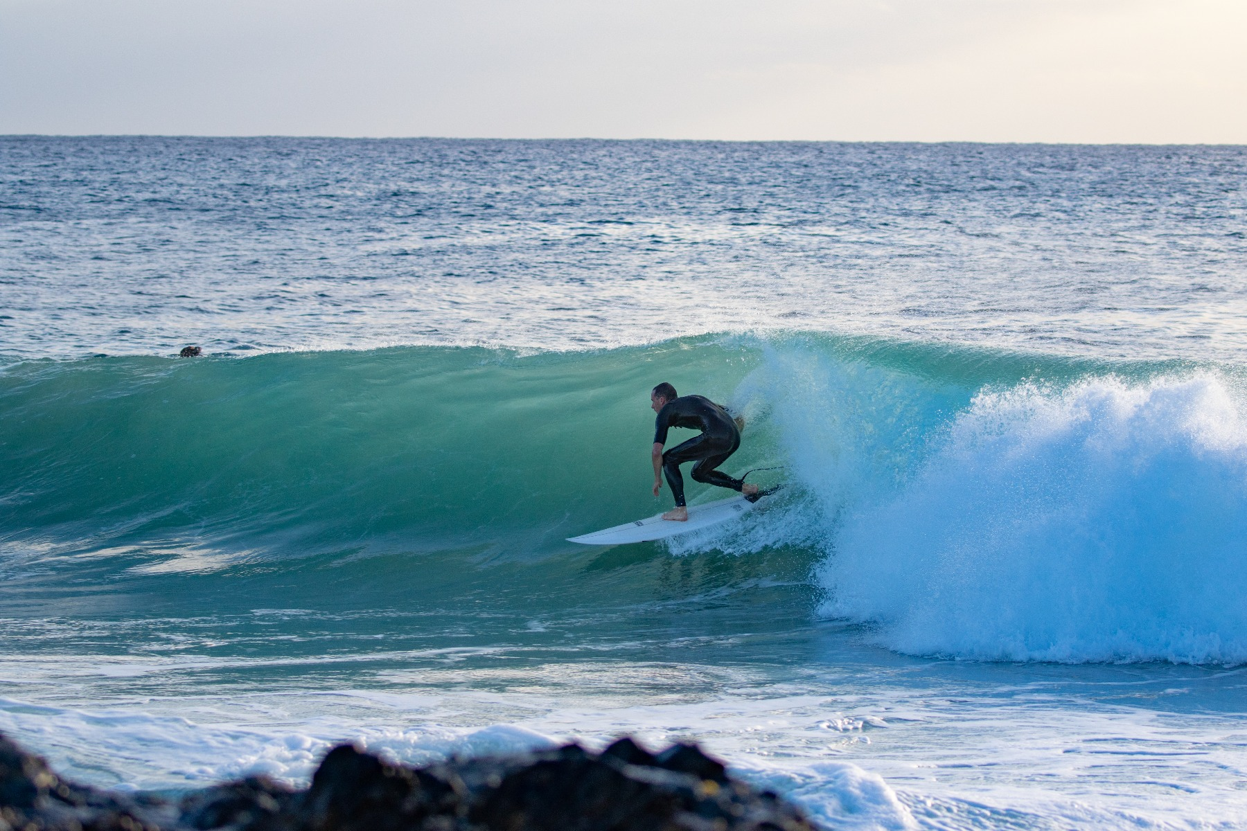 a man surfing on the beach