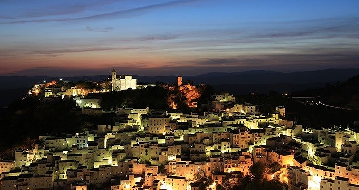 Mediterranean city buildings lit up beneath a darkening sky, photographed with the Canon 16-35mm f4 lens