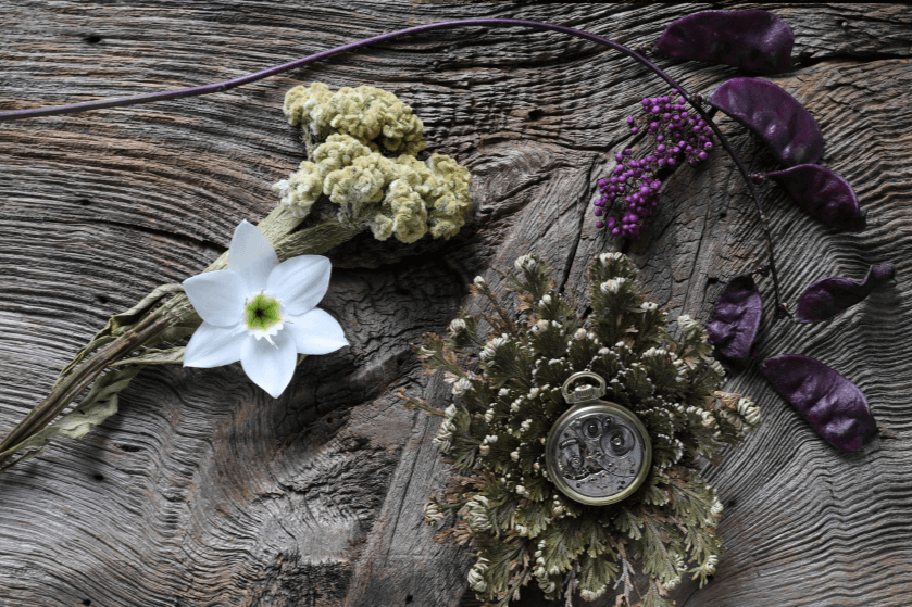 Flowers and a brass pocket watch arranged on a textured timber surface, photographed with the Canon 1DX Mark II