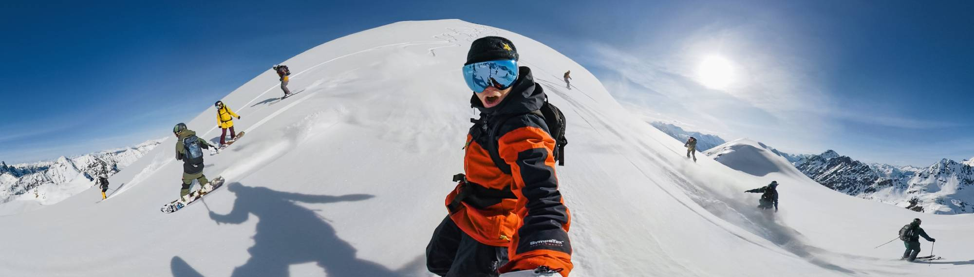 270° panoramic photo of snowboarders and skiers on snowy mountain peak, shot on the GoPro MAX 360 action camera
