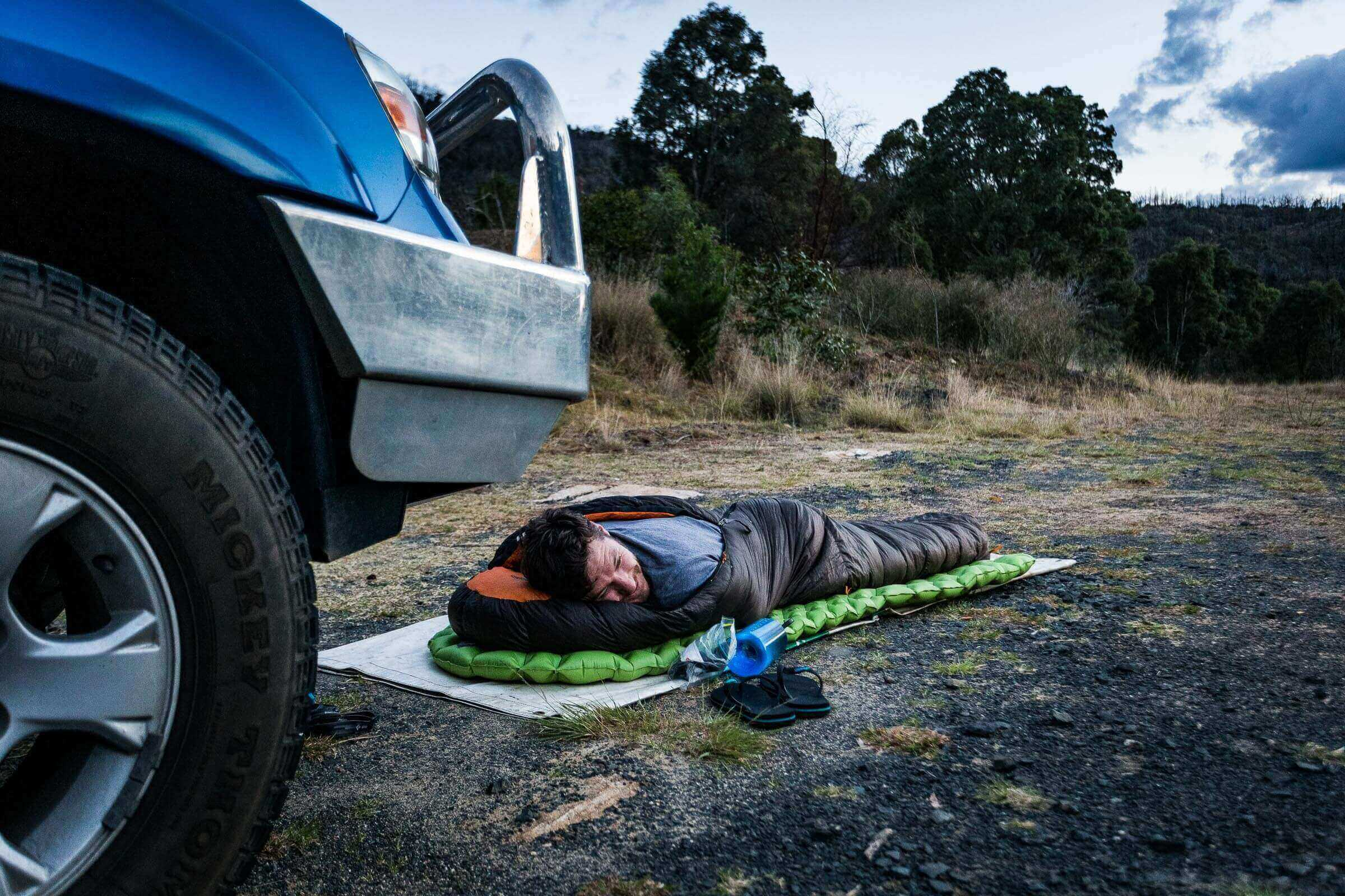 The not-so-glamorous side of adventure: Dave Stone sleeping beside the road on the way to a rock climbing destination