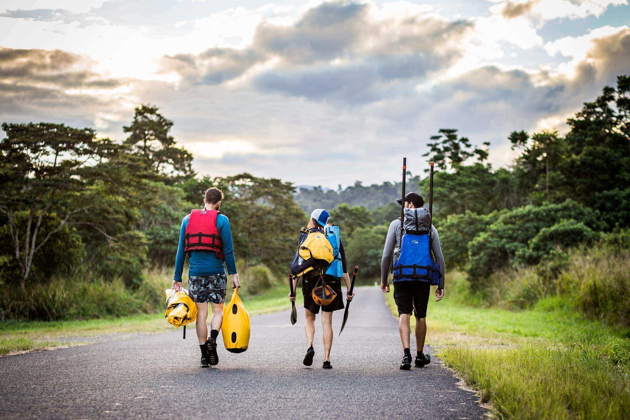 Walking back to camp after a day of whitewater packrafting on the Tully River in north Qld