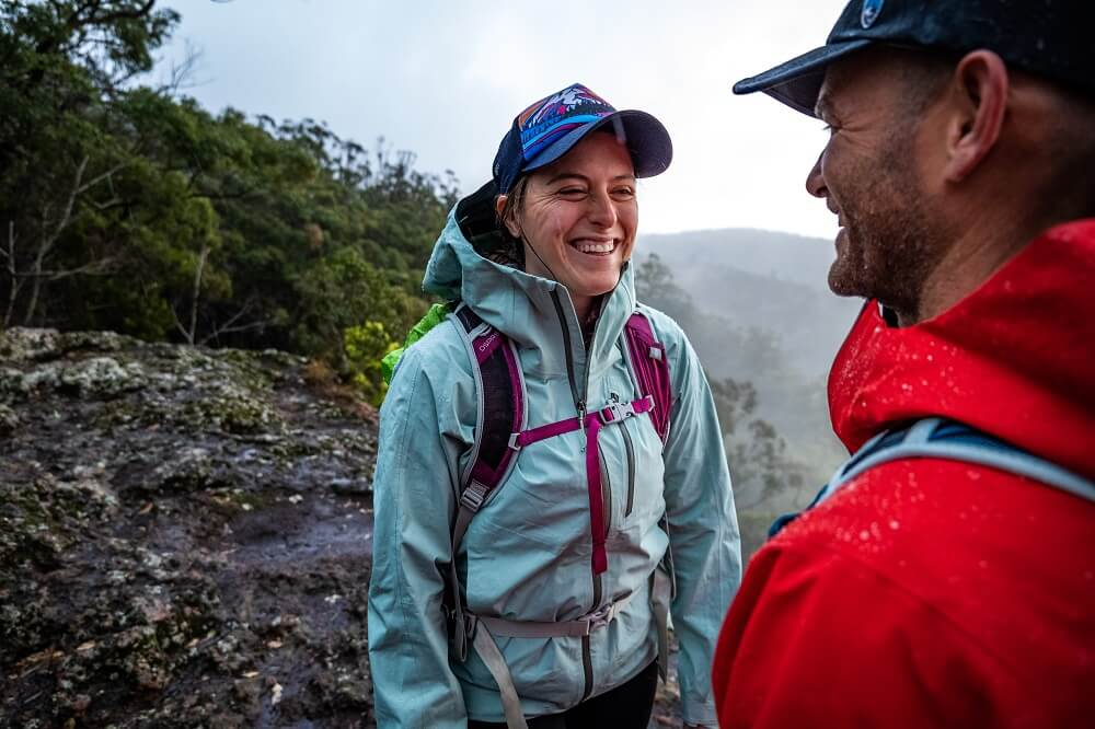 Two mountaineers facing each other while smiling, photographed using the Panasonic Lumix S5