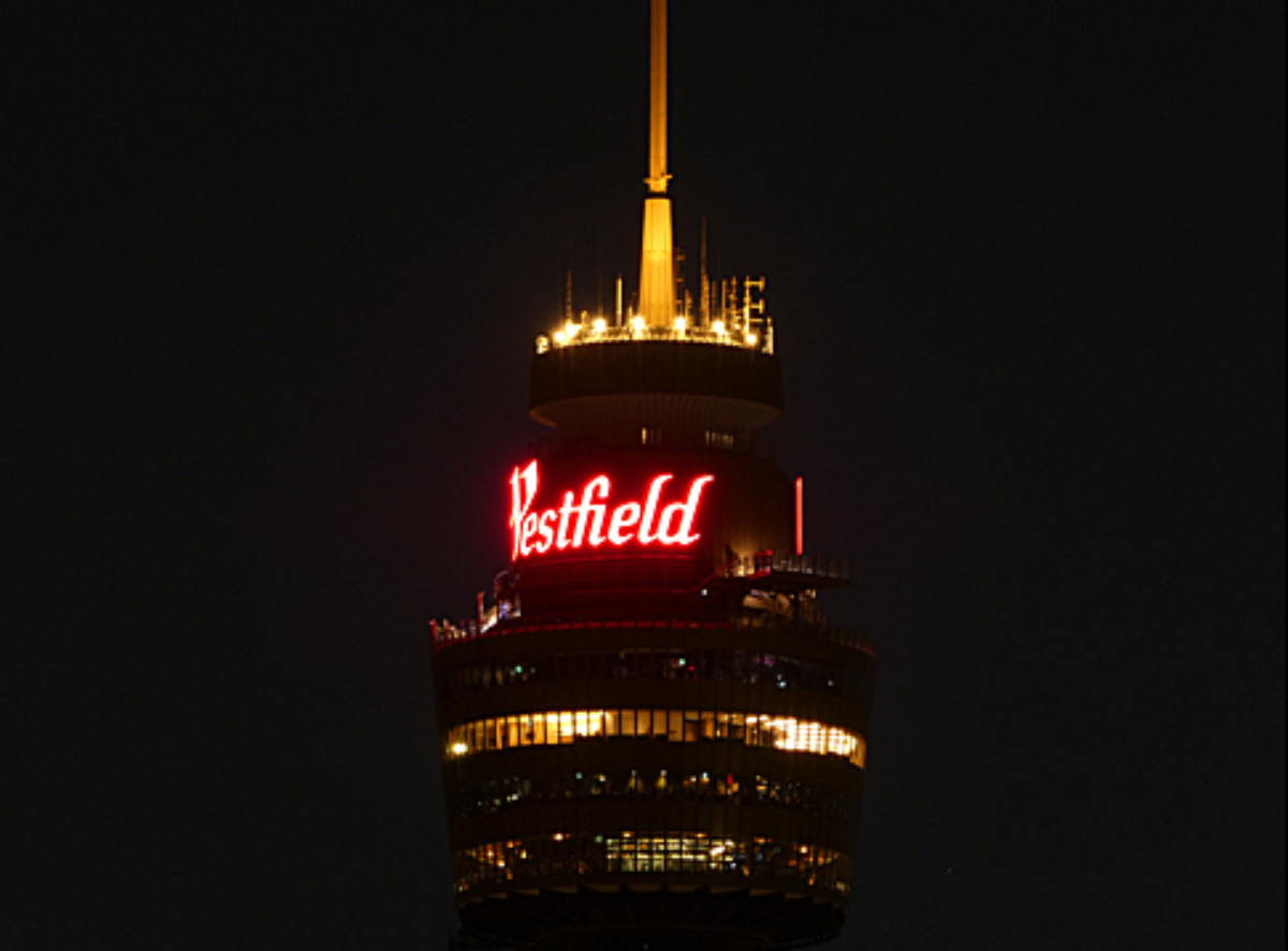 The top of Sydney Tower lit up at night, photographed with the Panasonic Lumix TZ90 Compact Camera