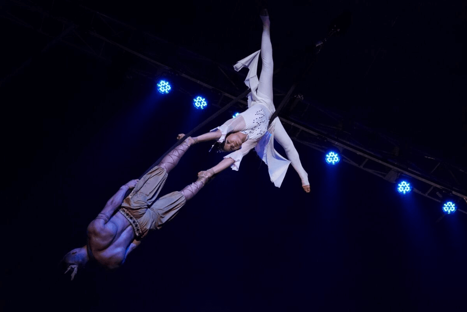 Male and female acrobats performing together on a trapeze, photographed with the Sony 70-200mm f4 G OSS Lens