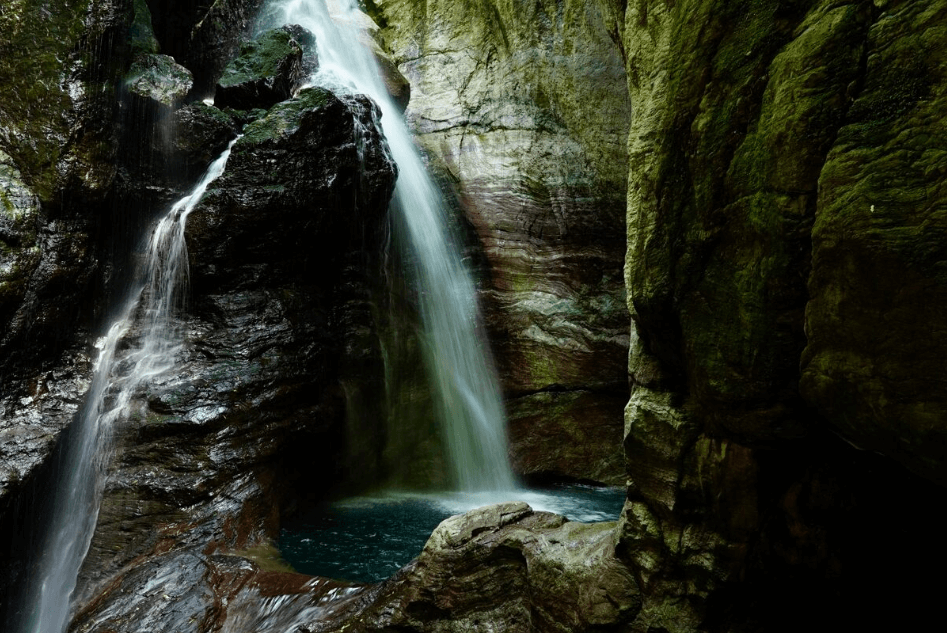 Waterfalls pooling inside a rocky cave, photographed using the Sony 24 to 70mm f4 Zeiss lens