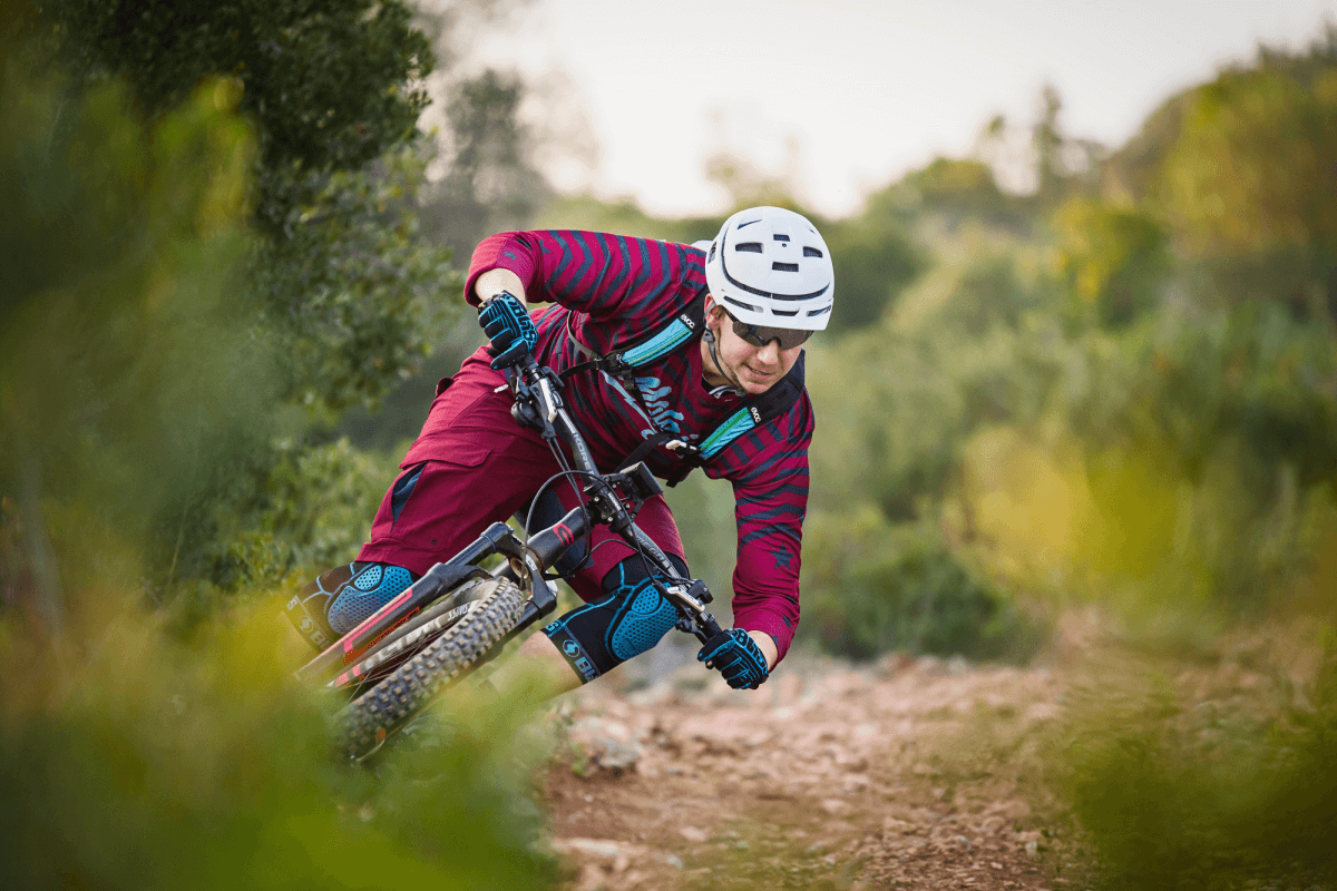 Trail bike rider leaning into a corner, photographed with the Tamron 70-200mm F/2.8 Di VC USD G2 for Nikon lens
