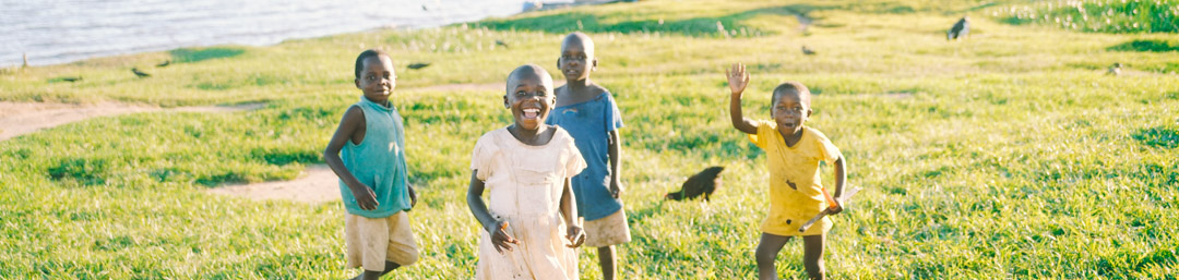 Kids in a Ugandan Orphanage Playing by the Lake
