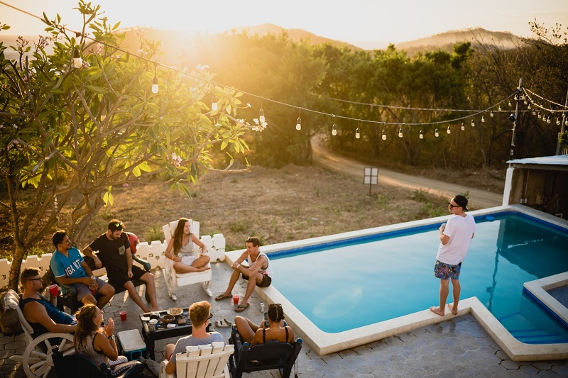 pool party with friends during sunset