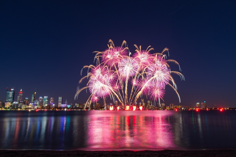 fireworks photography in the city skyline
