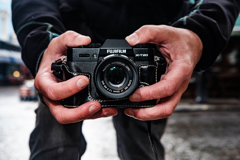 street photographer taking pictures using a fujifilm camera