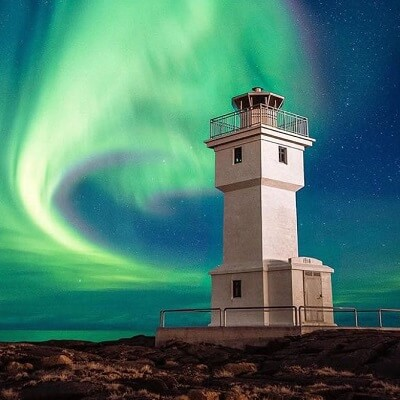 light house with aurora