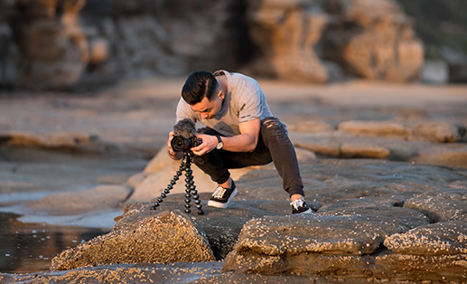 photographer taking a photo of the sunset